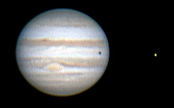 Jupiter showing the Great Red Spot and a shadow transit of Europa.